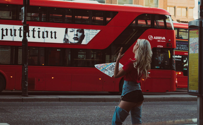 Adults Only City People One Woman Only Adult Fuel Pump Women Outdoors One Person Standing Land Vehicle Transportation Neon London Double Decker Bus Red