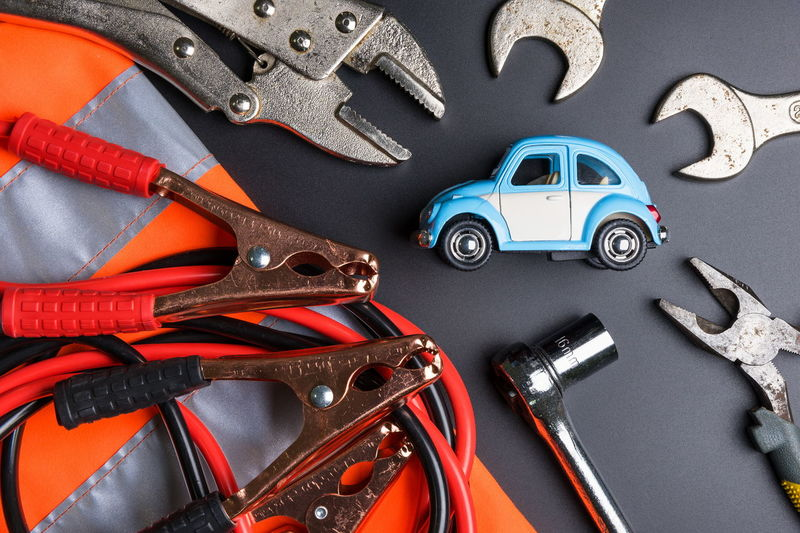 High Angle View Of Toy Car With Hand Tools On Table