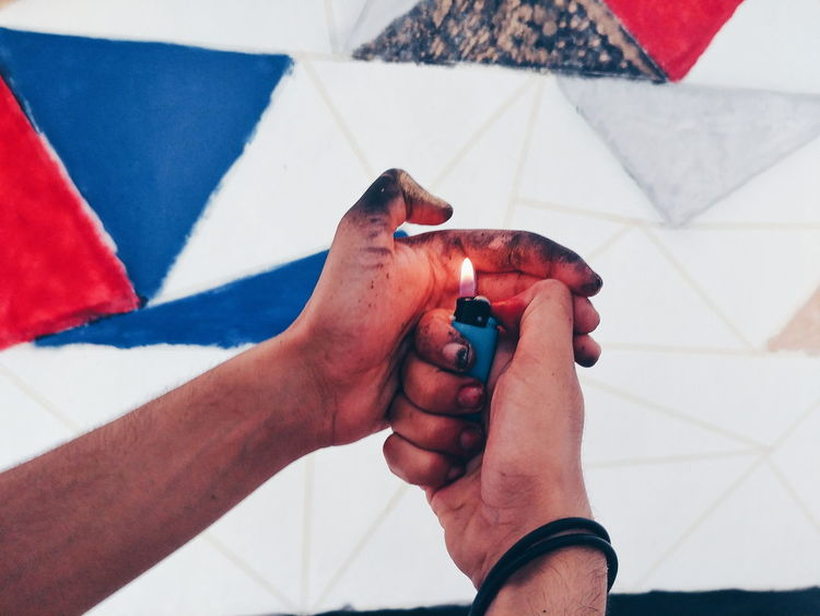 EyeEm Selects Human Hand Human Body Part Holding Flag Adult One Person Indoors  Lifestyles Adults Only People Only Women Day One Woman Only Close-up Painting Lighter Dirtyhands