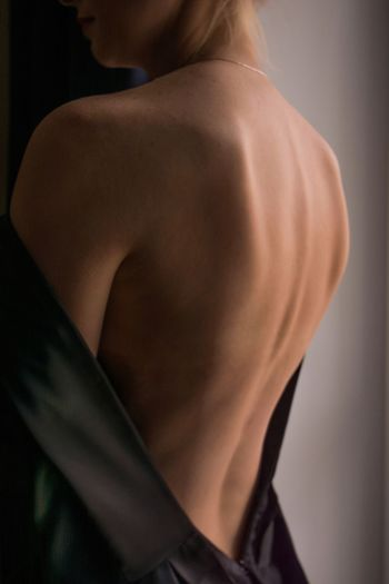 Rear view of shirtless man looking away