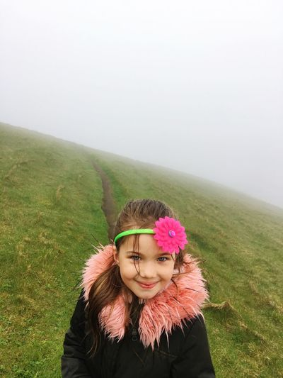 White ( fog ) is unpredictable future, green ( grass ) is life, happiness and daughter. One Person Real People Plant Lifestyles Nature Copy Space The Portraitist - 2018 EyeEm Awards Fog Smiling Front View Portrait Leisure Activity Beauty In Nature Young Women Day Environment Outdoors Hairstyle Warm Clothing Land