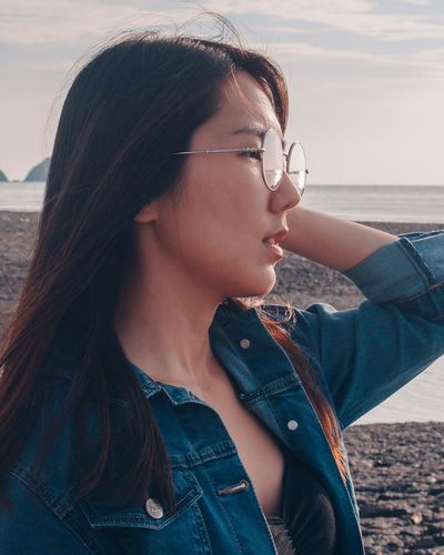 Casual Clothing One Person Real People Lifestyles Young Women Leisure Activity Outdoors Sky Beauty In Nature Eyeglasses  Beautiful Woman Close-up Young Adult Denim Jacket Sea Nature Beach Day Water EyeEm Ready
