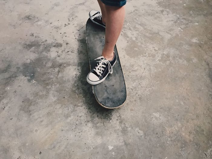 Low Section Human Leg Shoe High Angle View One Person Real People Sport Human Body Part Lifestyles Standing Day Men Outdoors Skill  Skateboard Park Sportsman People