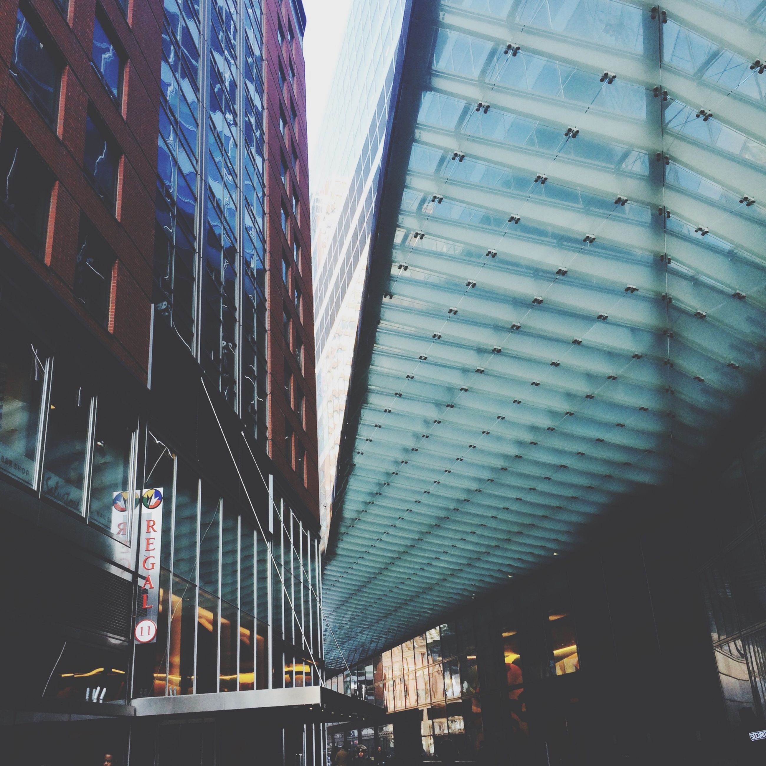 architecture, built structure, building exterior, low angle view, modern, glass - material, city, building, office building, window, reflection, sky, day, skyscraper, no people, outdoors, city life, pattern, transparent, diminishing perspective