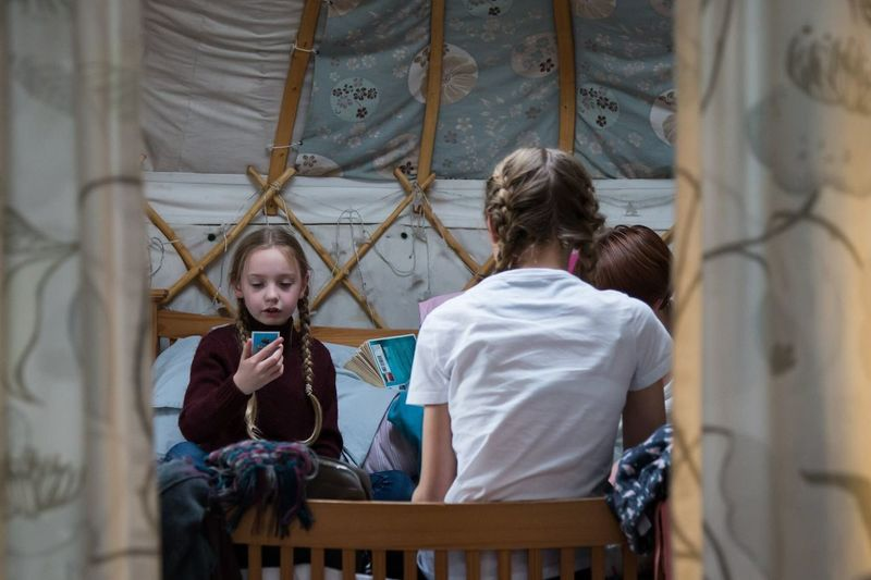 Family play card games in a yurt on holiday - technology detox Two People Child Childhood Togetherness Indoors  Real People Mature Adult Young Adult People Adult Working Day Workshop No Phones Detox Tech Detox Traditional Values Values Of Life Family Family Values Games Traditional Games