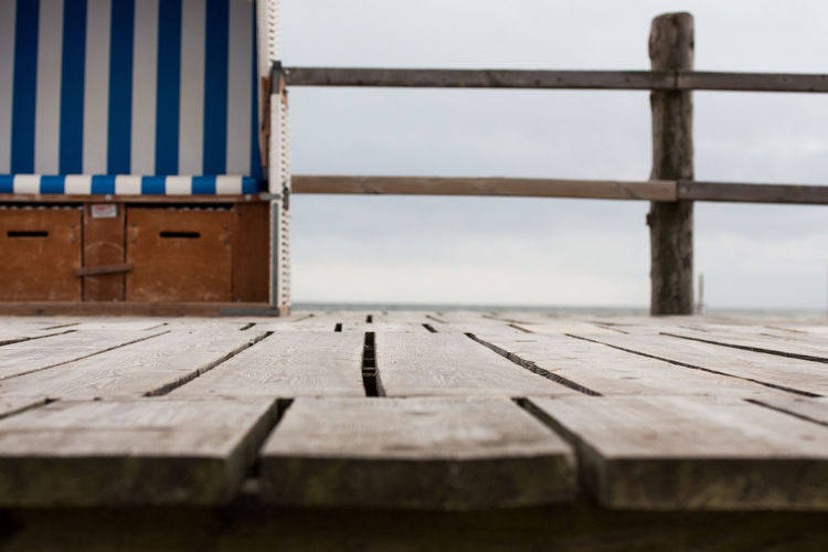 empty white striped beach chair on the beach Cloudy Wood Beach Beach Chair Beach Chairs In Germany Brown Close-up Day No People Northsea Outdoors Seaside Sky Striped Wood - Material Wood Paneling