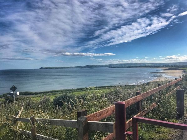 The view from the greenway Sea Horizon Over Water Sky Railing Nature Cloud - Sky Scenics Tranquility Water Tranquil Scene Day Beauty In Nature Outdoors No People Growth Grass dungarvan