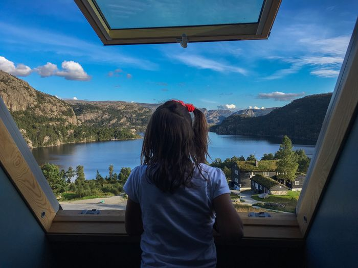 View Window Contemplating Rear View Water One Person Sky Real People Leisure Activity Nature Child Standing Childhood