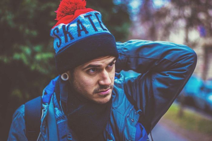 Young Adult One Person Young Men Knit Hat Casual Clothing Real People Cap Portrait Headshot One Young Man Only Looking At Camera Lifestyles Front View Warm Clothing Standing Outdoors Men Close-up Flat Cap Adults Only