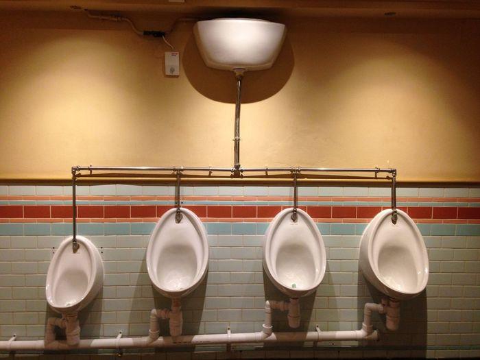 Row of urinals at public restroom