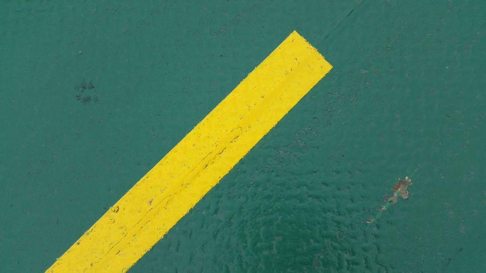 Yellow on green High Contrast High Angle View Green Paint Green Metal Metal Floor Boat Road Markings Yellow Close-up