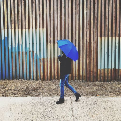 Full Length Real People One Person Protection Day Outdoors People Blue Rusty Wall Umbrella Minnesotaphotographer