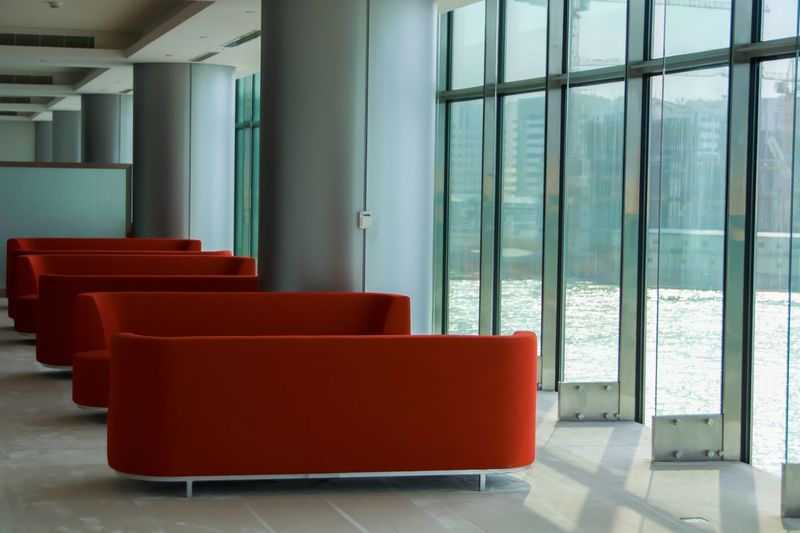 Abu Dhabi UAE Clean Medical Aesthetic Couch Window Red Indoors  Glass - Material Absence No People Seat Empty Architecture Furniture Lobby Entrance Day Building Tiled Floor
