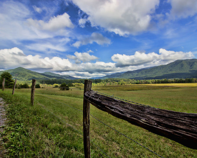 Smoky Mountains with Fence Sky Cloud - Sky Landscape Environment Barrier Boundary Fence Grass Scenics - Nature Tranquil Scene Land Tranquility Beauty In Nature Field Wood - Material Nature Non-urban Scene Mountain No People Wooden Post Outdoors