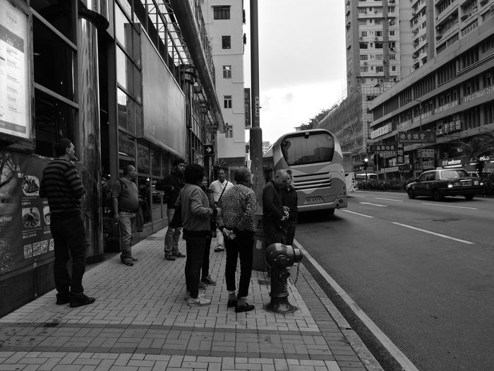 People queuing up for buses at Kowloon, Hongkong. It was a day before christmas celebration. City Street Walking City Street City Life Women Adult Men Outdoors People Day Street Photography Public Transport Mode Of Transport Modern Life