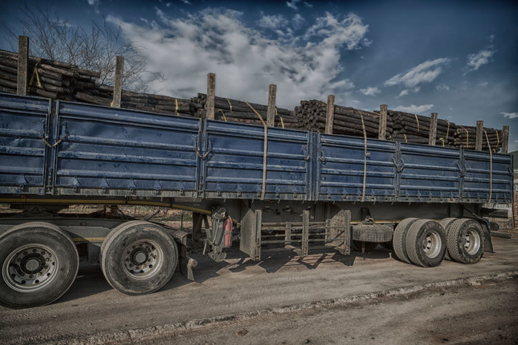 Truck Timber Logging Wood Lumber Log Forest Industry Transport Tree Industrial Vehicle Cargo Pine Lorry Machine Load Tractor Sawmill Trailer Deforestation Cut Equipment Road Stack Business Nature Trunk Environment Pile Background Material Machinery Mill Heavy Work Energy Alternative Raw Harvest