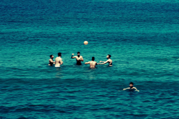 People playing in sea