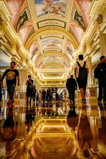 Casino Macau Illuminated Indoors  Architecture Ceiling Group Of People Lighting Equipment Built Structure Real People Ornate Travel Destinations Crowd Decoration Women Men Wealth Travel Incidental People Lifestyles Adult Arts Culture And Entertainment