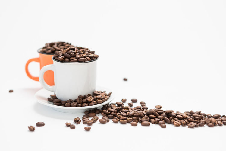 Coffee Cups Filled with Coffee Beans on a White Background Concept with Copy Space Food And Drink Food Still Life Roasted Coffee Bean Indoors  White Background Freshness Coffee - Drink Coffee Studio Shot Cup Brown No People Large Group Of Objects Drink Mug Copy Space Coffee Cup Refreshment Coffee Bean Crockery