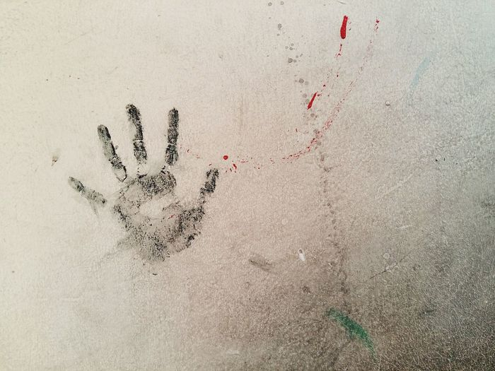Close-up of handprint on wall