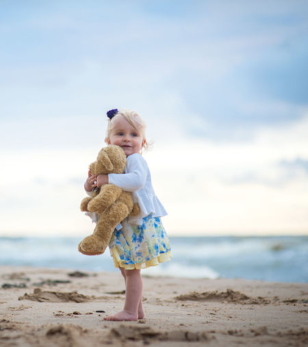 Beach Beauty Blond Hair Child Childhood Children Only Cloud - Sky Cute Friendship Full Length Girl Happiness One Girl Only One Person People Sea Sky Smiling Stuffed Toy Sunset Teddy Bear Vacations Uniqueness EyeEmNewHere The Portraitist - 2017 EyeEm Awards