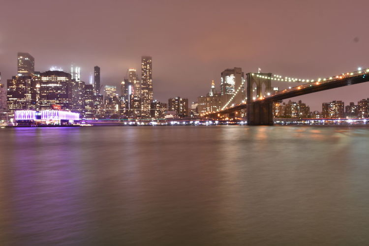 New York Brooklyn Bridge / New York Manhattan New York New York City Architecture Bay Bridge Building Built Structure City Cityscape Connection Financial District  Illuminated Light Nature Night Office Building Exterior Outdoors Reflection River Sky Skyscraper Water Waterfront