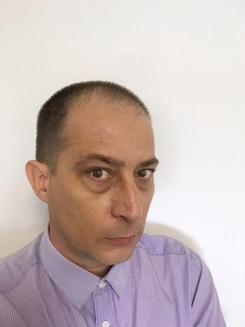 Man against a wall. Portrait Headshot One Person Looking At Camera White Background Businessman Real People Close-up People Short Hair One Man Only Copy Space Man Buttoned Shirt Looking At Camera Front View