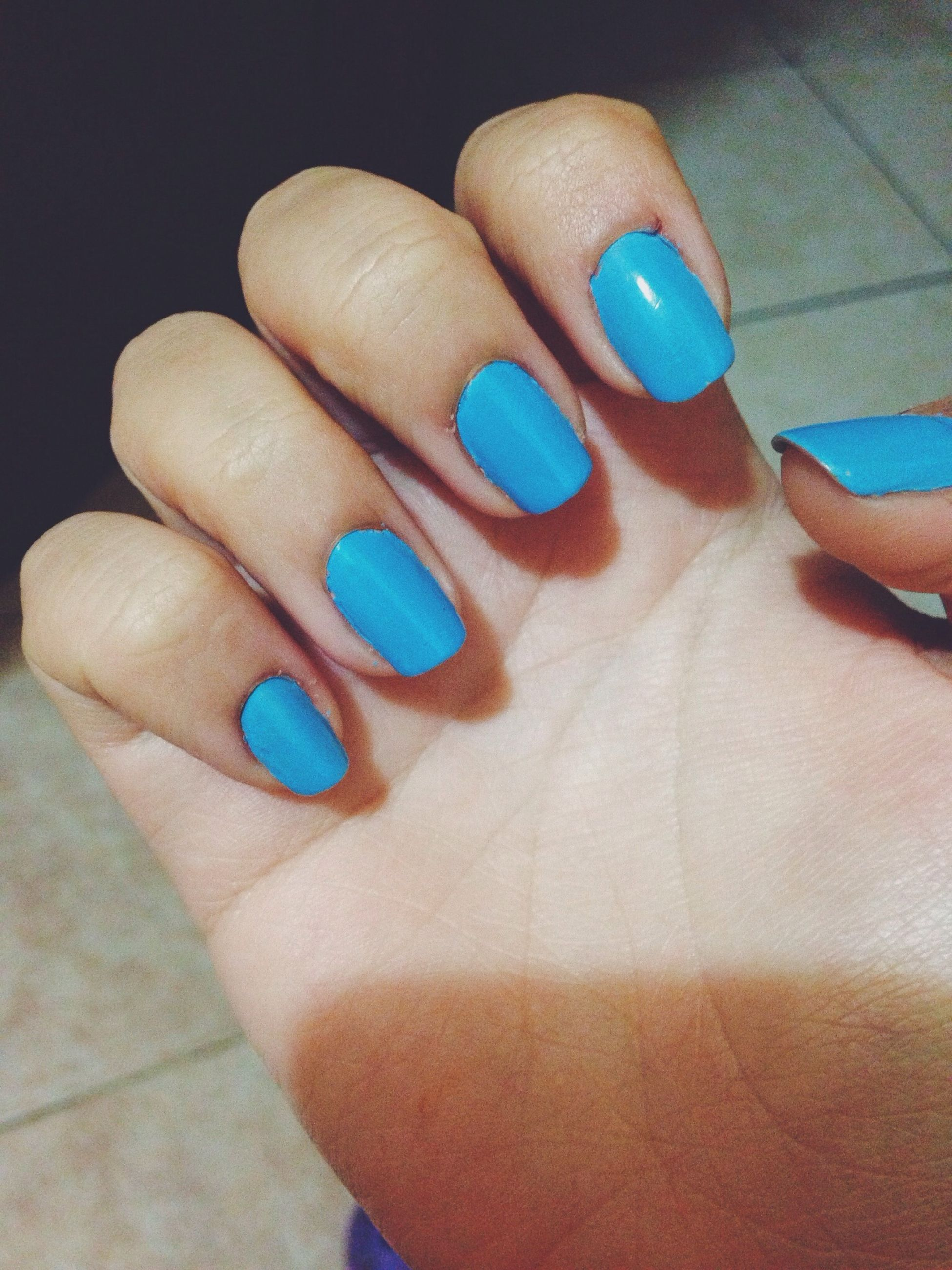 person, indoors, part of, close-up, multi colored, human finger, cropped, holding, blue, high angle view, personal perspective, unrecognizable person, nail polish, still life, fashion, variation, leisure activity