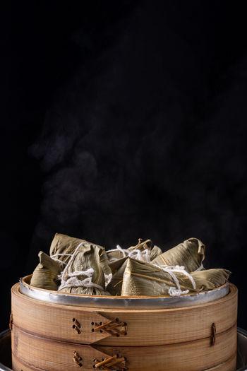 Zongzi rice dumpling for dragon boat festival over dark background.