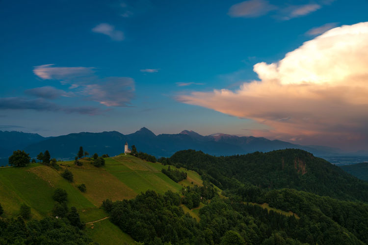 Jamnik at sunset Beauty In Nature Church Cloud Exposure Grass Hill Idyllic Landscape Long Mountain Range Nature Outdoors Pasture Photography Scenics Sky Slovenia Summer Sunset Trees