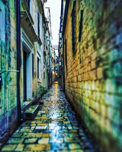 Live Life To The Fullest Live The Moment  See The World Differently Alley Architecture Brick Building Building Exterior Built Structure City Day Diminishing Perspective Direction Footpath Live Authentic Long Narrow No People Outdoors Paving Stone Photowalktheworld Residential District See The World Through My Eyes Selective Focus Street The Way Forward Travel Destinations Wall Wall - Building Feature