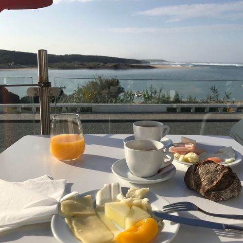 Fantastic Ocean view with Breakfast in Hotel Ocean Ocean View Restaurant Hotel Travel Travel Destinations Freshness Tourism Tourist Destination Food And Drink Coffee Cup Fruits Fruit Cheese! Breakfast Orange Juice In Glass Orange Juice  Water Refreshment Glass Panorama Outdoors No People Happy