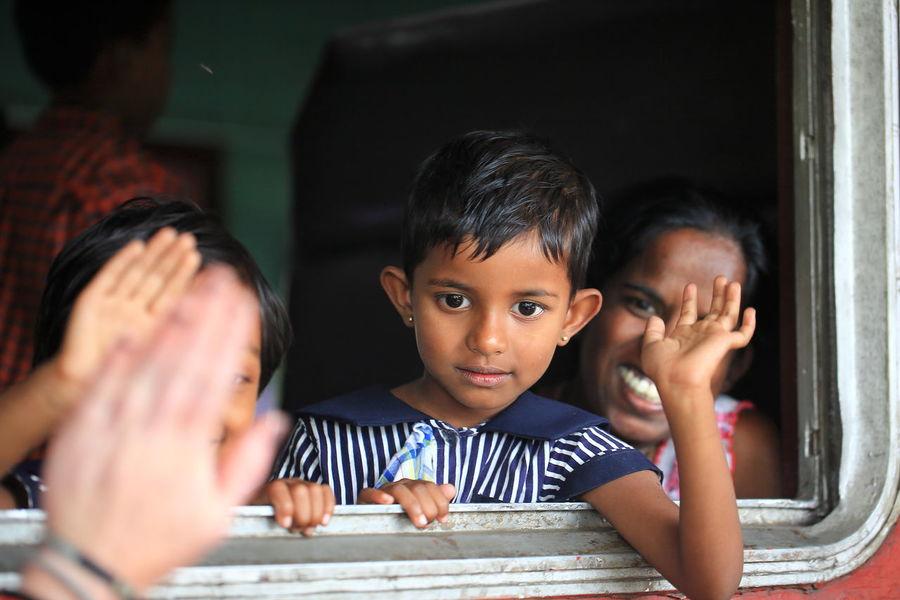 child waving in Kandy railway station, Sri Lanka Childhood Focus On Foreground Friendship Happiness Headshot Joyful Moment Joyful Moments Joyful Smile Looking At Camera Looking In Your Eyes Peace And Love Sri Lanka Sri Lankan Kids Togetherness Virginity People And Places People And Places. An Eye For Travel