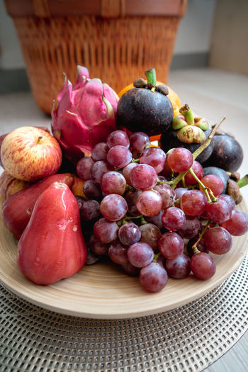 Close-up of grapes in plate on table