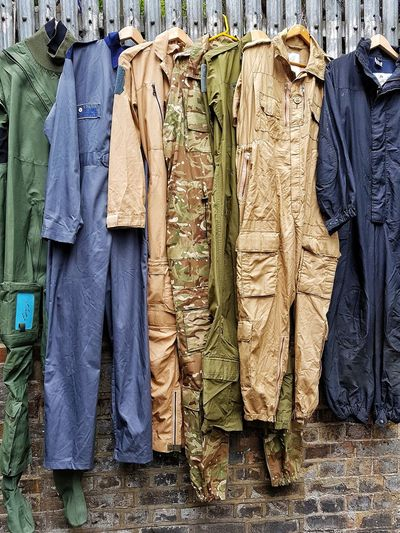 Ex military Army Uniform Fatigues Vintage Vintage Uniforms Vintage Market Old Clothes Army Outfits Hanging Clothes Veterans Army War Sale Shopping Buying Display Market Stall Overalls Second Hand Market Used Clothes