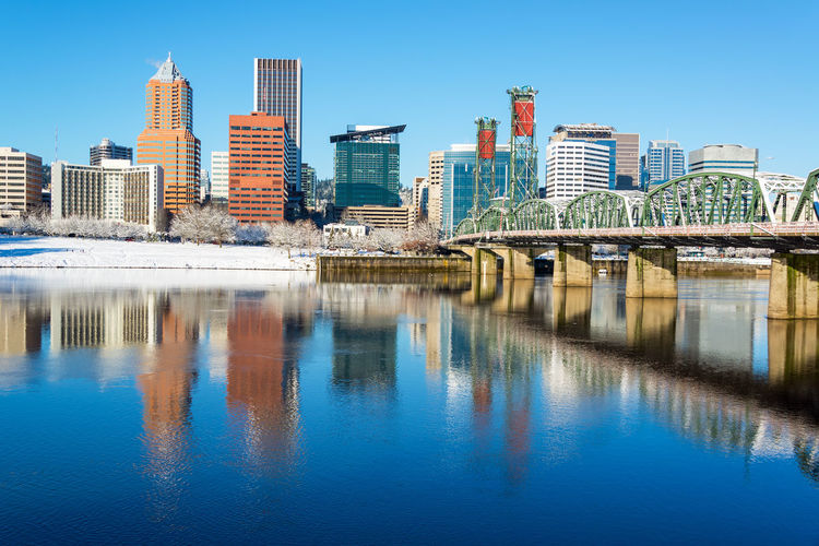 Downtown Portland, Oregon beautifully reflected in the Willamette River with the Hawthorne Bridge Architecture Bridges City Cityscape Downtown Ice Mirror Oregon Pacific Portland Reflection Willamette River  Winter Bridge Cold Colorful Conventioncenter Infrastructure Morrison Northwest Park River Snow Urban Waterfront