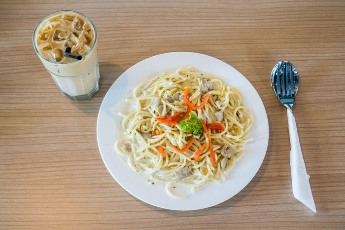Sphagetti White Sauce Bowl Close-up Cream Sauce Day Dinning Table Food Food And Drink Fork Freshness Garnish Grated Healthy Eating High Angle View Indoors  Indulgence Italian Food No People Plate Ready-to-eat Restaurant Serving Size Table