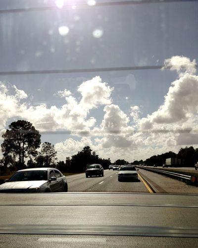 On The Road Looking Backward Through The Window Florida Sky Freelance Life