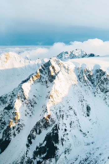 The peak. Sky Beauty In Nature Scenics - Nature Tranquil Scene Tranquility Cold Temperature Winter Non-urban Scene Cloud - Sky Nature Snow Sea Environment Landscape Land No People Mountain Water Snowcapped Mountain Outdoors