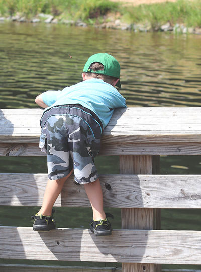 The fish got away... Childhood Day Fishing Got Away Lake Leisure Activity Littleboy Nature One Person Outdoors Sunlight Water Wood - Material
