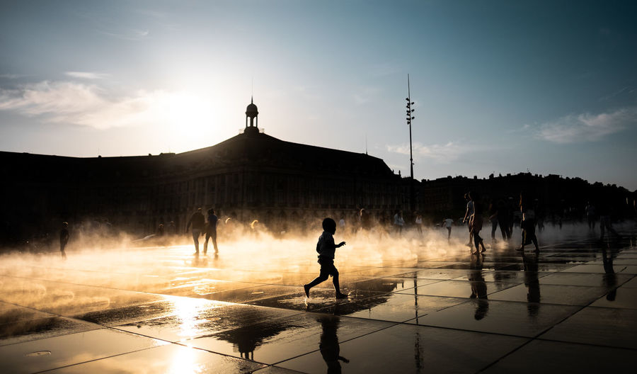 Beautiful sundown at Miroir d'Eau, Bordeaux, France. Bordeaux City France Gold Kids Miroir D'eau - Bordeaux Sunlight Travel Travel Photography Blue Sky Day Fog Fujifilm Fujifilm_xseries Golden Hour History Playing Shadow Silhouette Street Street Photography Streetphotography Sundown Sunset Water Summer In The City