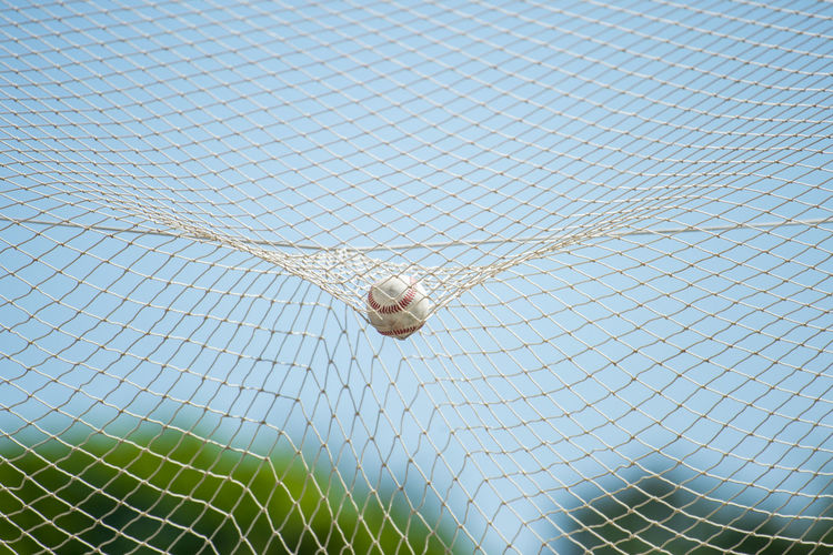 Baseball ball on field Baseball Clubbing Sportsman Active Activity Animal Baseball - Ball Baseball - Sport Baseball Cap Baseball Field Close-up Club Net Net - Sports Equipment Netting No People No Person Sport Sports Sports Photography Timeout