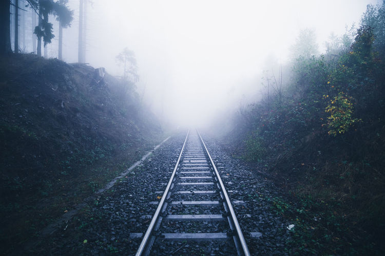View of railroad tracks on foggy day