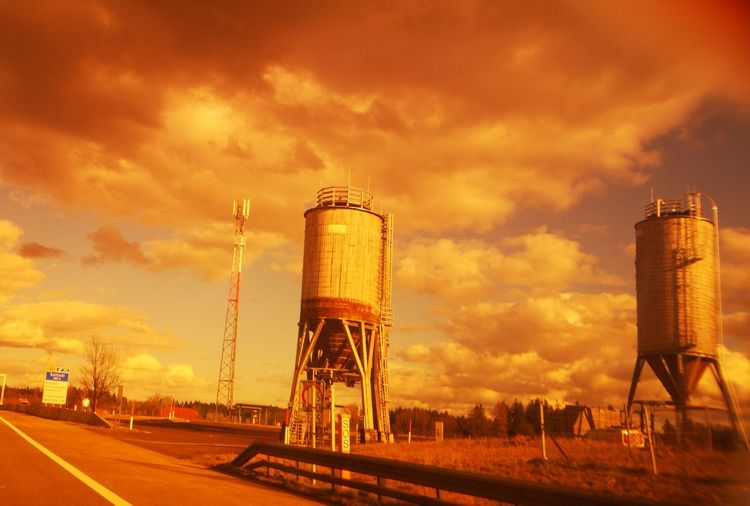 Low angle view of water tower against sky during sunset