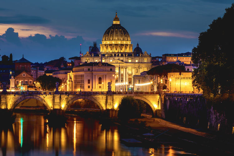 Ponte sant angelo over tiber river in city at night