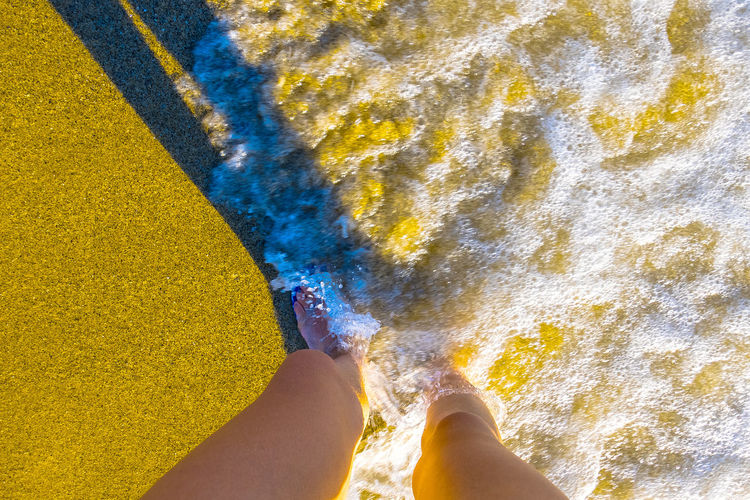 Close-up Day Directly Above High Angle View Human Body Part Human Leg Low Section One Person Outdoors People Powder Paint Real People Sand Standing Water Yellow