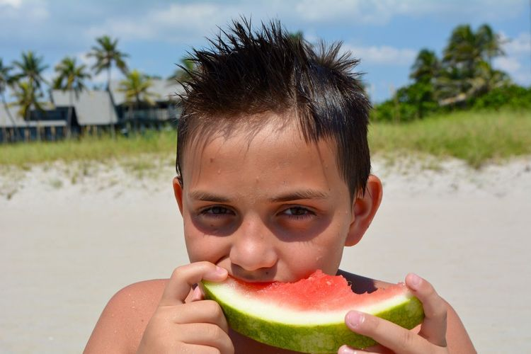 Watermelon Eating Watermelon Small Kids Portrait Food And Drink Fruit Healthy Eating Food One Person Looking At Camera Headshot Wellbeing Leisure Activity Freshness Front View Focus On Foreground Real People Lifestyles Beach Childhood Land Melon Outdoors Summer Watermelon🍉 Nikon Young Boy Eating Good