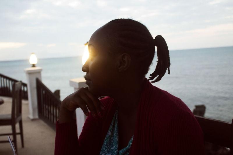 Sundowner EyeEm Selects EyeEmNewHere Water Sea Young Women Women Headshot Portrait Sunlight Sky Close-up Horizon Over Water Thoughtful Introspection Day Dreaming Shining Contemplation Eyelid Silhouette Sunset Thinking Sun Hand On Chin Shore