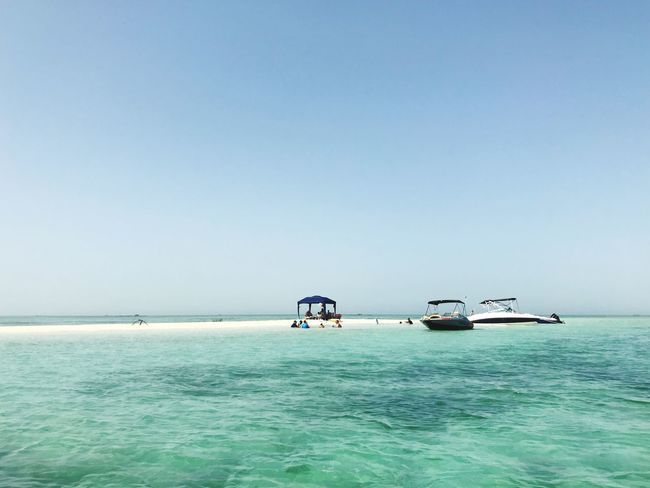 A stretch of sand in the middle of the Gulf has to be paradise Boat Beach Sea Water Sky Nautical Vessel Clear Sky Transportation Mode Of Transportation Beauty In Nature Nature Tranquility Blue