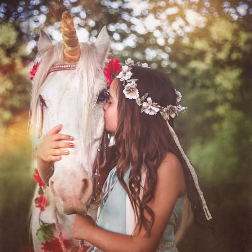Girl with flower hair wreath hugging and kissing white unicorn. Dreams come true Dreams Dreams Come True Hugging Love Nature Sunny Unbelievable Unicorn Feelings Flower Wreath Forest Friendship Girl Horse Kissing Magic Magical Creature Make A Wish Portrait Springtime Summer Sun Beam Sunset Tenderness White